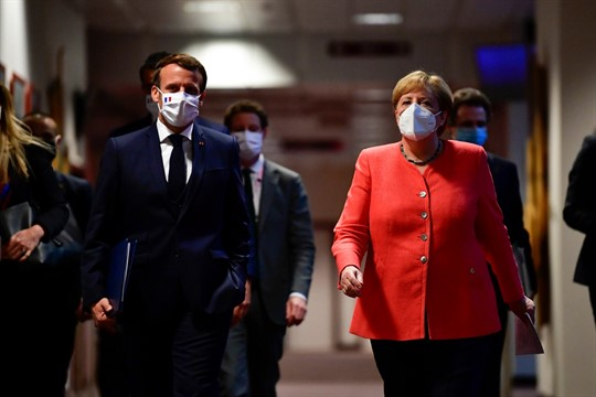 German Chancellor Angela Merkel and French President Emmanuel Macron at the end of an EU summit