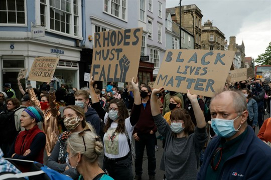 Protesters call for the removal of a statue of Victorian imperialist Cecil Rhodes, in Oxford, England