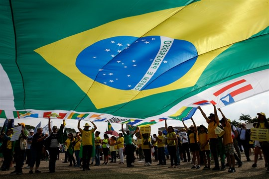 Demonstrators hold a Brazilian flag to support Operation Car Wash and former judge Sergio Moro