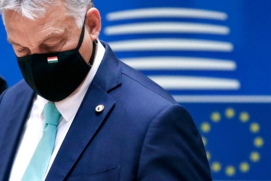 Hungary's prime minister, Viktor Orban, wears a protective face mask at an EU summit in Brussels.