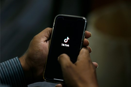 A man opens the social media app TikTok on his cell phone, in Islamabad, Pakistan