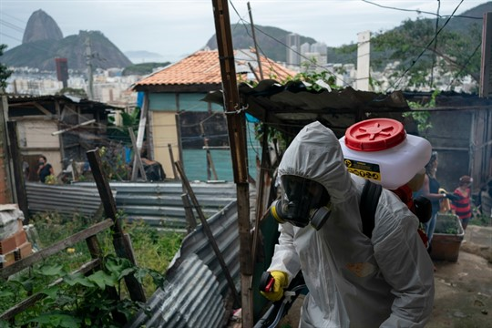 A volunteer sprays disinfectant to help contain the spread of the coronavirus in Rio de Janeiro.