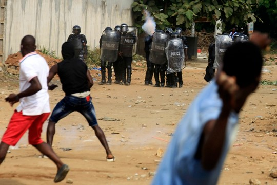 Demonstrators opposed to President Alassane Ouattara running for a third term confront riot police in Abidjan