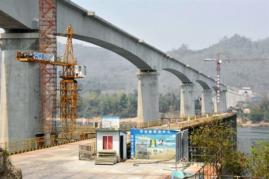 A railway bridge over the Mekong River under construction in the suburbs of Luang Prabang, Laos