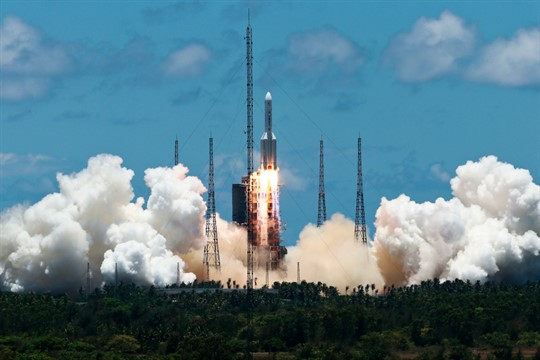 A CZ-5 rocket, carrying China's first Mars explorer, lifts off in Hainan province, southern China.