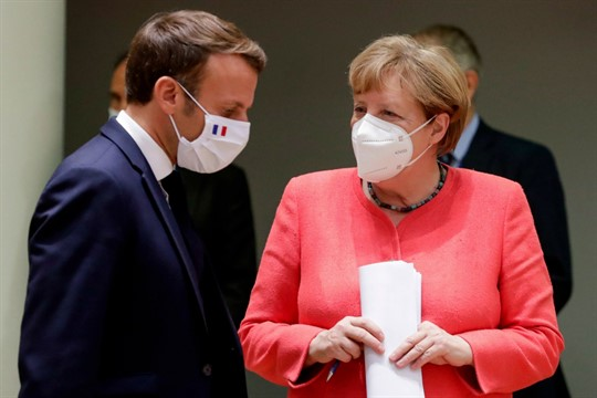 German Chancellor Angela Merkel, right, and French President Emmanuel Macron at an EU summit in Brussels