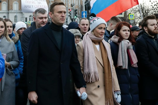 Russian opposition leader Alexei Navalny and his wife Yulia, during a march in Moscow
