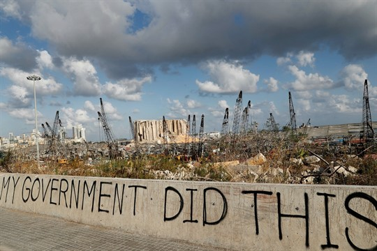 Graffiti written by Lebanese citizens in front of the scene of the explosion at Beirut's port