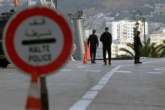 Algerian security forces at a coronavirus curfew checkpoint in Algiers