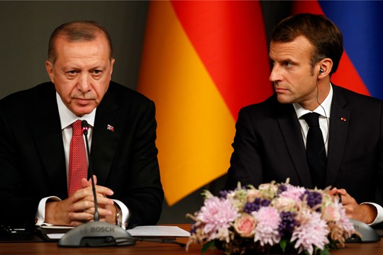 Turkish President Recep Tayyip Erdogan and French President Emmanuel Macron at a news conference in Istanbul