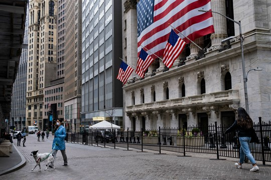 Streets and sidewalks are mostly empty near the New York Stock Exchange