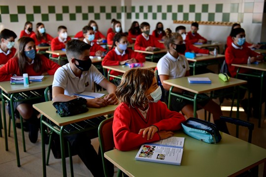 Young students wearing face masks attend their first day of class in Pamplona, Spain