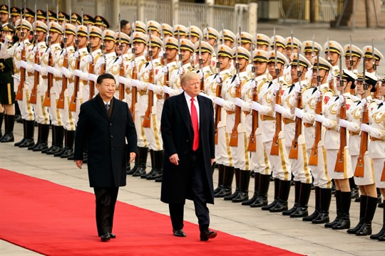 President Donald Trump and Chinese leader Xi Jinping attend a welcome ceremony in Beijing