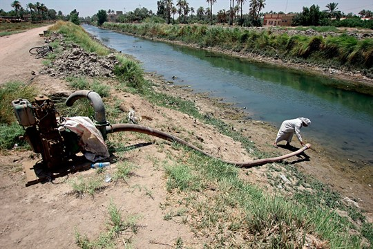 A farmer adjusts an irrigation pump in the Iraqi town of Mishkhab, south of Najaf.