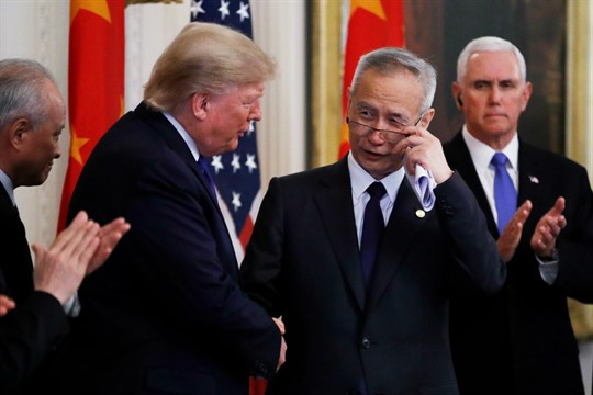 President Donald Trump shakes hands with Chinese Vice Premier Liu He at the White House