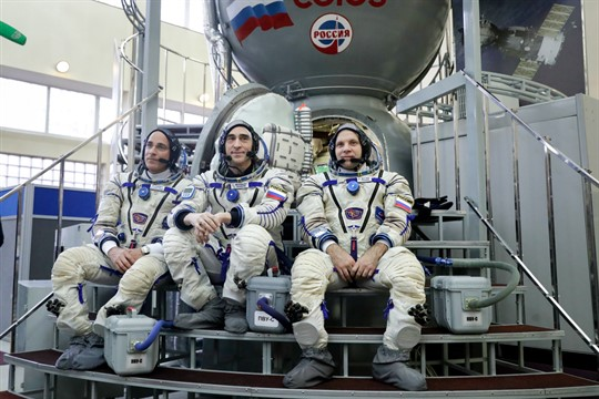American and Russian astronauts appear before their trip to the International Space Station