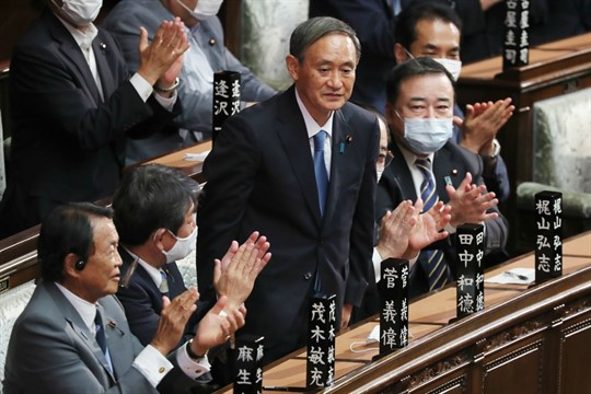 Suga Yoshihide receives applause after being elected as Japan's new prime minister, in parliament.