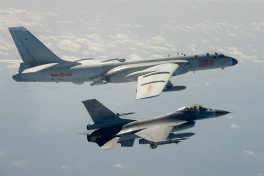 A Taiwanese F-16 flies on the flank of a Chinese H-6 bomber near Taiwan