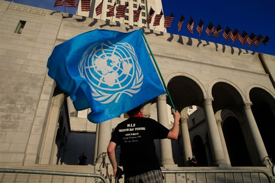 A protester holds a United Nations flag at a Black Lives Matter demonstration Angeles