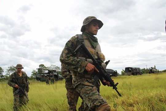 Paraguayan soldiers patrol an area where two German citizens were killed by the EPP in 2015