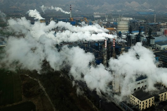 Smoke and steam rise from a coal processing plant in Hejin, China