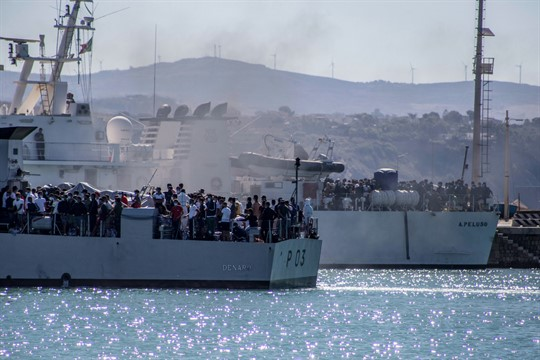 Migrants arrive in Porto Empedocle, Sicily, aboard two military ships after being transferred from Lampedusa.