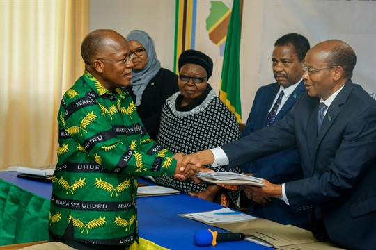 President John Magufuli hands in his nomination form to the chairman of the National Electoral Commission