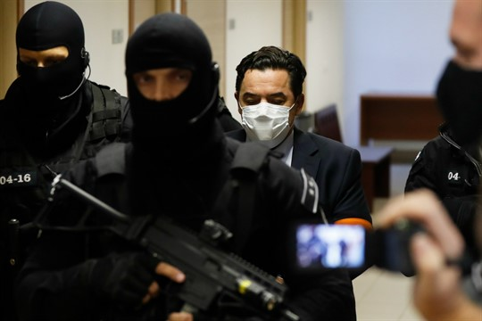 Marian Kocner is escorted by armed police officers to a courtroom for his trial, Pezinok, Slovakia