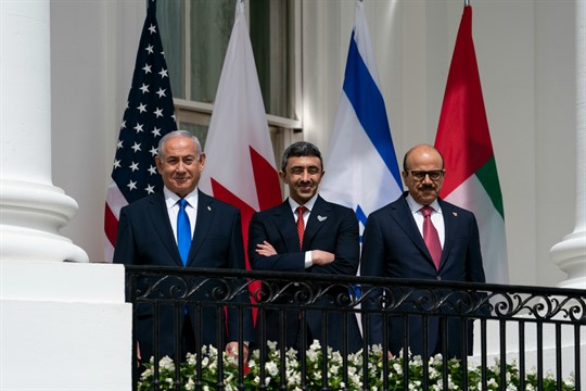 Benjamin Netanyahu with the foreign ministers of the UAE and Bahrain on a White House balcony.