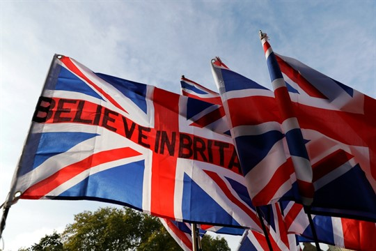 Pro-Brexit demonstrators fly flags outside Parliament in London