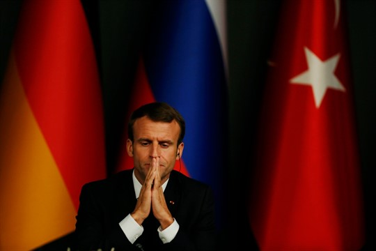 French President Emmanuel Macron listens during a joint news conference in Istanbul in 2018