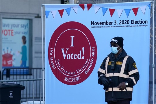 A security guard stands outside a voting center in San Francisco