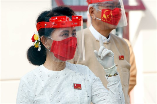 Myanmar's de facto leader, Aung San Suu Kyi, attends a ceremony at the NLD's temporary headquarters