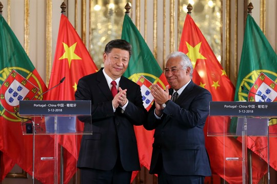 Chinese leader Xi Jinping and Portuguese Prime Minister Antonio Costa applaud after signing agreements