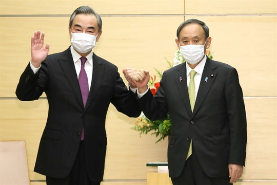 Japanese Prime Minister Suga Yoshihide and Chinese Foreign Minister Wang Yi in Tokyo, Japan