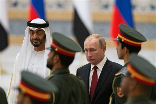 Russian President Vladimir Putin and Abu Dhabi Crown Prince Mohamed bin Zayed attend a welcome ceremony