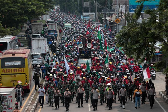 Indonesian workers protest against the controversial omnibus bill, in Tangerang, Indonesia