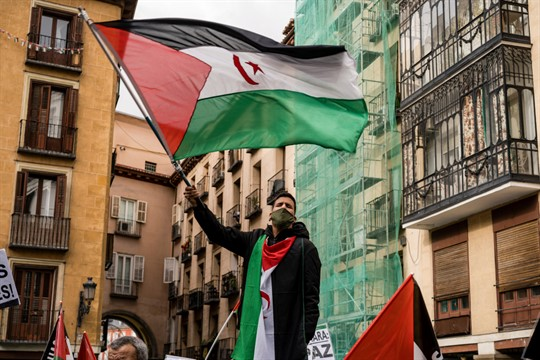 A protester waves the Sahrawi flag during a demonstration in Madrid, Spain