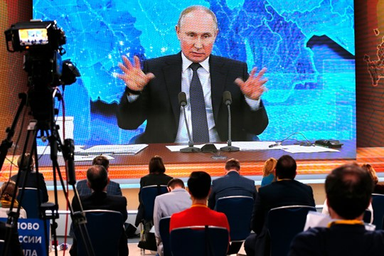 Russian President Vladimir Putin speaks via video call during a news conference in Moscow