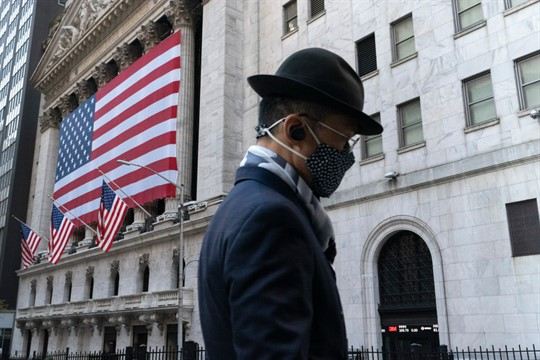 A man passes the New York Stock Exchange