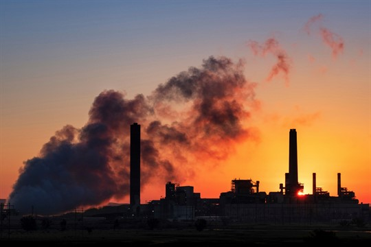 The Dave Johnson coal-fired power plant is silhouetted against the morning sun in Glenrock, Wyo.