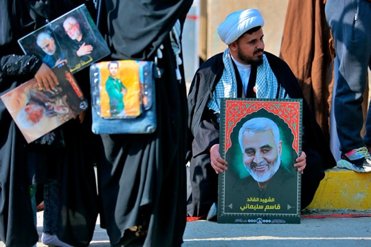 Supporters of the Popular Mobilization Forces commemorate the anniversary of the killing of Qassem Soleimani