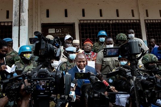President Faustin-Archange Touadera peaks to the media after casting his vote in Bangui, Central African Republic