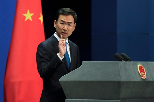 Former Chinese Foreign Ministry spokesman Geng Shuang at a briefing in Beijing