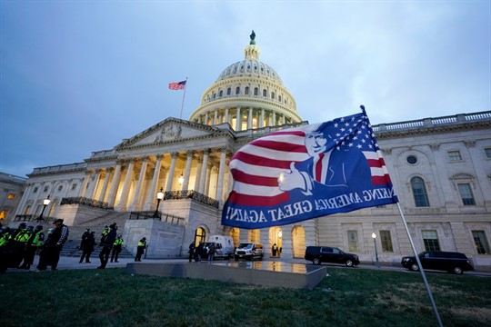 A Trump flag left behind by his supporters outside the Capitol, Washington