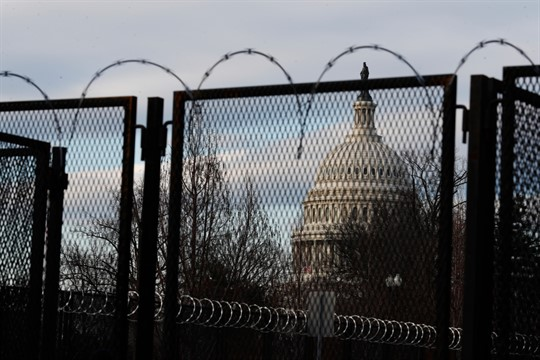 Steel fencing and barbed wire surround the Capitol building ahead of Joe Biden's inauguration