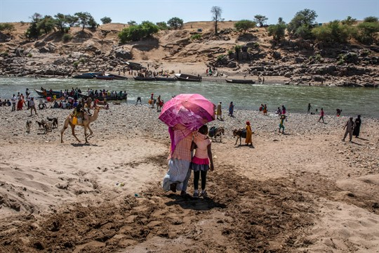 Refugees who fled the conflict in the Tigray region arrive to the Tekeze River, eastern Sudan