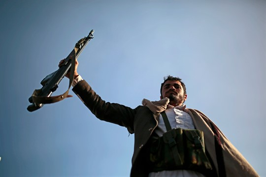 A Houthi supporter holds up his rifle during a demonstration in Sanaa, Yemen