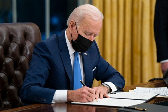 President Joe Biden signs an executive order on immigration at the White House