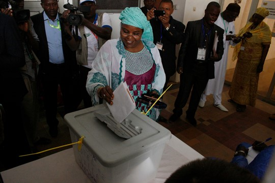A woman casts her ballot during elections, in Niamey, Niger